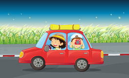 A girl and a boy riding in a red car Royalty Free Stock Image