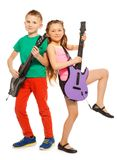 Girl and boy rock playing on electro guitars Royalty Free Stock Photos