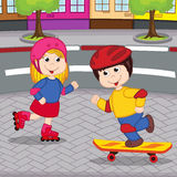 Girl and boy on rollerblading and skateboarding Royalty Free Stock Image