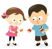 Girl and boy sharing sweets and fruits Stock Image