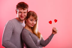 Girl with boy showing hearts. Royalty Free Stock Photography