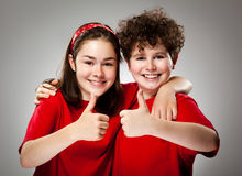 Girl and boy showing Ok sign Stock Photography