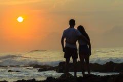 Girl Boy Silhouetted Beach Sunrise Ocean Royalty Free Stock Image