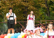 Girl and boy sing German songs Stock Photos