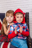 Girl and boy sitting on chair with a British flag Royalty Free Stock Image