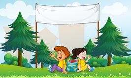 A girl and a boy sitting in the hill with an empty signage Royalty Free Stock Image