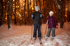 Girl and boy on ski at winter park Stock Photography