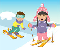 Girl and boy skiing in the mountains. Royalty Free Stock Image