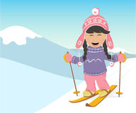 Girl and boy skiing in the mountains. Stock Image