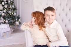 Girl and boy. Small children. Bright interior. Horizontally. Light background Stock Image