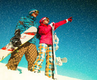 Girl and boy with snowboards on the snow Stock Photo