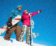 Girl and boy with snowboards on the snow Stock Photography