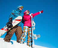 Girl and boy with snowboards on the snow Royalty Free Stock Images