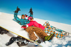 Girl and boy with snowboards on the snow stock photos