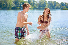 Girl and Boy splashing Royalty Free Stock Images