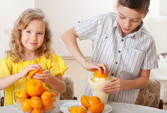 Girl and boy squeezed fresh juice Stock Image