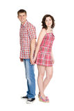 Girl and boy standing back to back Stock Photography