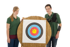 Girl and boy standing besides archery target Royalty Free Stock Photos