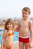 Girl and boy standing on cruise ship Stock Photos
