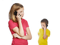 Girl and boy talking on phones Royalty Free Stock Photo