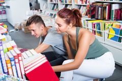 Girl and boy teenagers in book store Stock Image