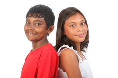Girl and boy teenagers posing together in studio stock photo