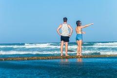 Girl Boy Watching Pool Ocean Waves Stock Photo