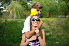 Girl and boy teens at the party in nature. In the summer Stock Image