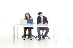 Girl and boy at their office busy working Royalty Free Stock Image