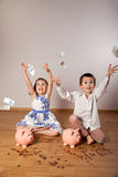 Girl and boy throwing banknotes Stock Image