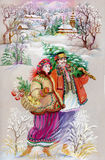Girl and boy in traditional clothes. Young girl and boy on Christmas Day with a tree Stock Images