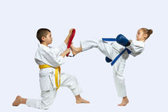 Girl and boy are training the blow mae geri on simulator Stock Images
