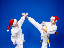 Girl and boy are training paired exercises karate Stock Images
