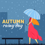 Girl and boy with umbrella in a autumn raining day Stock Image