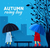 Girl and boy with umbrella in a autumn raining day Royalty Free Stock Image