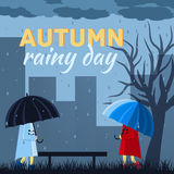 Girl and boy with umbrella in a autumn raining day Royalty Free Stock Images