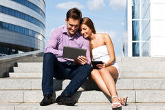 Girl with boy at the University of  tablet computer Stock Image