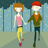 Girl and boy walking in the city street at naight Royalty Free Stock Images