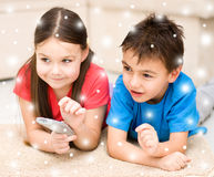 Girl and boy watching tv Royalty Free Stock Photography