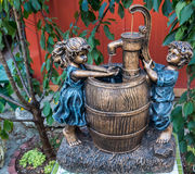 Girl and boy water fountain Stock Photography