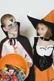 Girl And Boy Wearing Halloween Costumes Stock Images