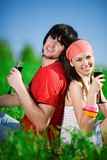Girl and boy with wineglasses on grass Stock Images