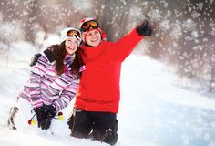 Girl and boy in winter park Royalty Free Stock Image
