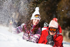 Girl and boy in winter park Stock Photos