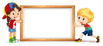 Girl and boy by the wooden frame Stock Image