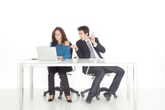 Girl and boy working busy and surprized in office Stock Photo