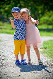 The girl with the boy wriggle. Stock Photo