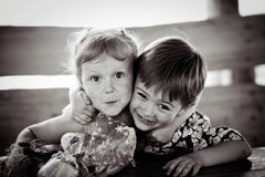The girl with the boy wriggle. Monochrome. Royalty Free Stock Photo