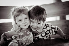 The girl with the boy wriggle. Monochrome. Stock Photography