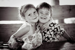The girl with the boy wriggle. Monochrome. Stock Photos